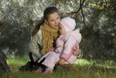 Family. Mother embraces the small daughter Stock Images