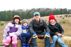 Family. Sitting on a vagon on Christmas tree farm Royalty Free Stock Photo