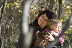 The family. Mother and the daughter on the nature, mother embraces the small daughter Stock Image