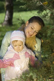 The family. Mother and the daughter on the nature, mother embraces the small daughter Stock Photo