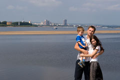 Family. The young family near the river Royalty Free Stock Photography
