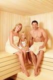 Family. Happy family in the sauna Stock Image