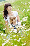 Family. Smiling mother and little daughter on nature. Happy people outdoors Stock Images