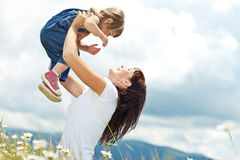 Family. Smiling mother and little daughter on nature. Happy people outdoors Stock Image