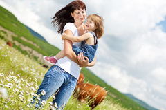 Family. Smiling mother and little daughter on nature. Happy people outdoors Royalty Free Stock Photography