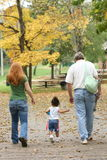 Family. Members walking through the park Stock Photos