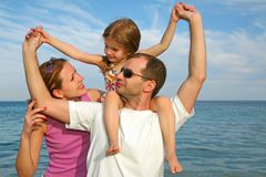 Family. Mother, daughter and father on the sea royalty free stock images
