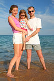 Family. With child at the sea royalty free stock image