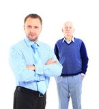 Family. Portrait of a relaxed son standing with his father behind against white background Royalty Free Stock Photography
