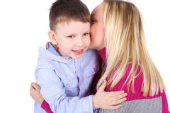 Family. Cute little boy embracing his beautiful mother Stock Photography