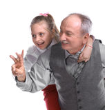 Family. Portrait of a little girl enjoying piggyback ride with her grandfather on a white background royalty free stock images