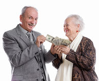 Family. Senior men and old women with money on white background Stock Photo