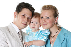 Family. Young parents pose with the favourite daughter Stock Photos