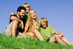 Family. Happy healthy smiling loving young family fun with pet dog Stock Photo