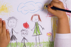 Family. Little girl drawing a happy family Stock Photos