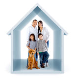 Family in a 3D house Royalty Free Stock Photo