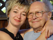 Family. Young woman and her grandfather Stock Image