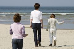Family. Walking on the beach royalty free stock images