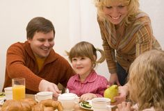 Family. Happy family have a breakfast at the table Royalty Free Stock Image