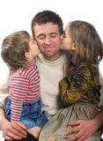 Family. Little children are kissing his father Stock Images