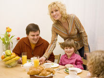 Family. Have a breakfast at the table Royalty Free Stock Photos