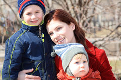 Family. Young mum with two boys in the street Stock Photos