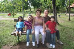 Family. Grandparents and grandchildren having fun in the park Stock Photo