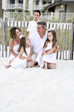 Family of 5. On the beach, 2 girls, 1 boy, Mother and Father in brown tones Royalty Free Stock Photos