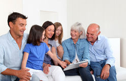 Family of 6 using tablet at home Royalty Free Stock Photo