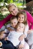 Family. Mother and children playing at the park stock photography