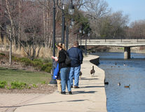 Family. Strolling along the river Royalty Free Stock Photography