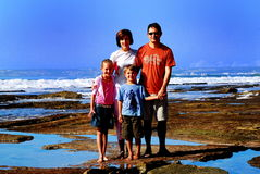 Family. Happy family of four at the beach Stock Photos