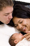 Family. A young couple with a new born baby Stock Photos