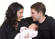 Family. A young couple with a new born baby Stock Photo