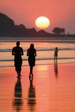 Family. Goes for a walk on a beach on sunset Royalty Free Stock Images