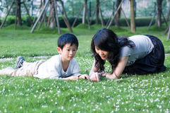 Family. Happy mother and son, playing on the grass Royalty Free Stock Photo