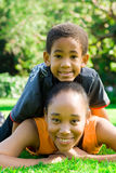 Family. Happy african american family, mother and son outdoors Stock Images
