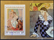 Family of acrobats with Monkey by Pablo Picasso. A stamp printed in Central African shows family of acrobats with Monkey by Pablo Picasso stock image