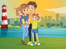 A family across the lighthouse Stock Image