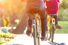 People active bicycle ride in the park at sunset background royalty free stock photography