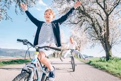 Family active leisure - father and son have a fun when they ride. A bicycles stock photos