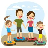 Family Hoverboard. Family activity having fun with self balancing electric scooter hoverboard on outdoor park together Royalty Free Stock Photo