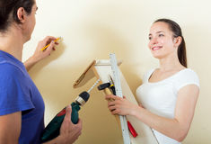 Family activity in home interior Stock Images