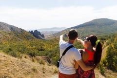 Family admires beautiful mountain landscape Stock Image