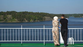 Family admires Scandinavian landscapes from the deck of a large sea ferry stock video