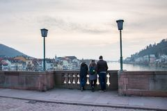 Family admiring the view from old bridge of Heidelberg Royalty Free Stock Images