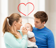 Family and adorable baby with feeding-bottle Royalty Free Stock Photography