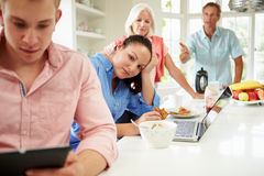 Family With Adult Children Having Argument At Breakfast Royalty Free Stock Photos