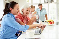 Family With Adult Children Having Breakfast Together Stock Photos