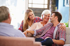 Family With Adult Children Relaxing On Sofa At Home Together Royalty Free Stock Photos